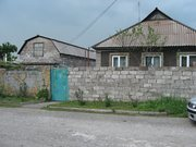 Срочно продается дом с 2-мя гаражами,  в связи с переездом.